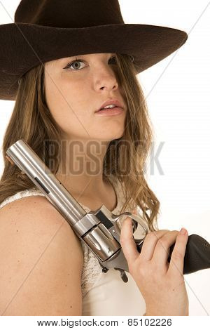 Tough Cowgirl Holding Large Pistol Hair In Face Glaring At Camera