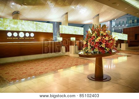 DUBAI, UAE - APRIL 18, 2014: airport interior. Dubai International Airport is a major international airport located in Dubai, and is the world's busiest airport by international passenger traffic.