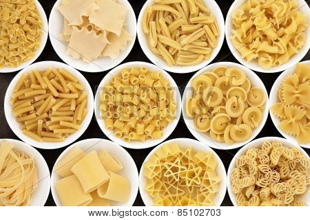 Pasta dried food selection close up in white porcelain bowls