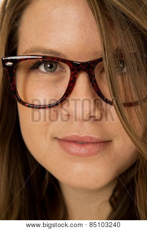 Atrractive Female Model Portrait Wearing Red And Black Glasses
