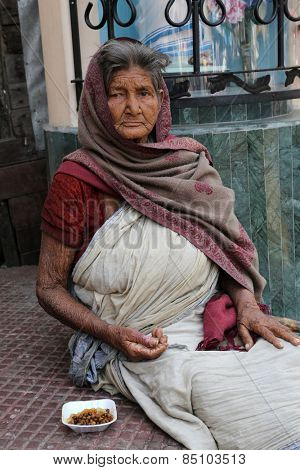 KOLKATA, INDIA - FEBRUARY 10, 2014: Beggars in front of Nirmal, Hriday, Home for the Sick and Dying Destitutes established by the Mother Teresa and run by the Missionaries of Charity in Kolkata, India