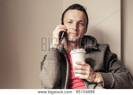 Portrait Of Young Man Sitting In Cafe