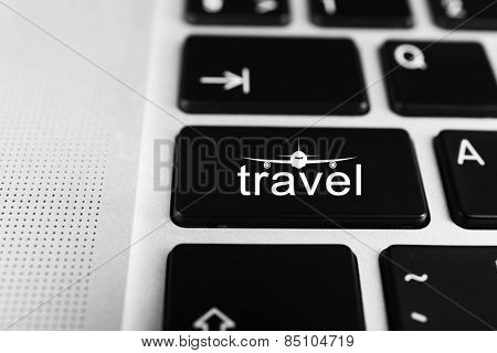 Travel concept. Keyboard of modern laptop close up