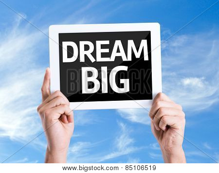 Tablet pc with text Dream Big with sky background