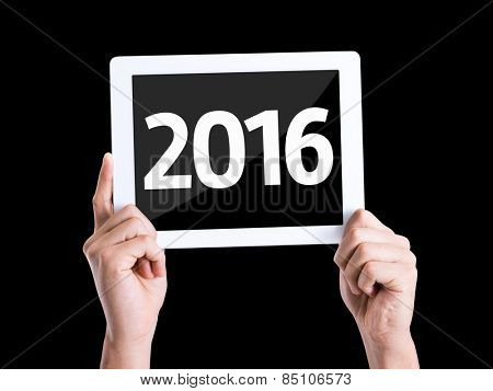 Tablet pc with text 2016 isolated on black background