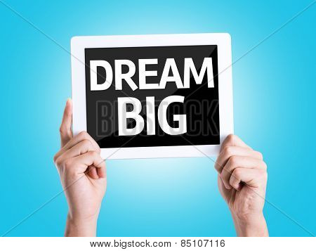 Tablet pc with text Dream Big with blue background