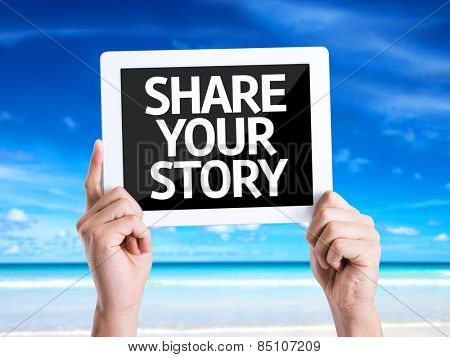 Tablet pc with text Share Your Story with beach background