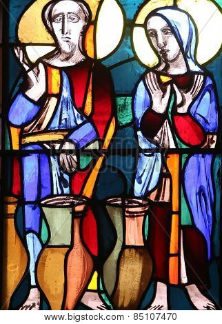 ELLWANGEN, GERMANY - MAY 07: Wedding at Cana, stained glass window in Basilica of St. Vitus in Ellwangen, Germany on May 07, 2014.