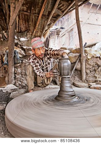 BHAKTAPUR, NEPAL - APRIL 5: Bhaktapur indigenous potter makes earthenware with turning wheel on April 5, 2009 in Bhaktapur, Nepal.