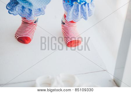 red striped baby socks in a studio Christmas