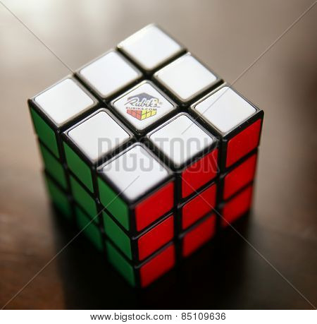 Boise, ID - March 8, 2015: A Rubik's cube on a table in natural light (shallow depth of field). The Rubik's cube is a challenging three dimensional puzzle or game.