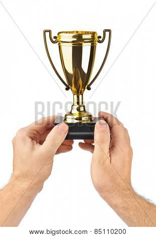 Golden trophy cup in hands isolated on white background