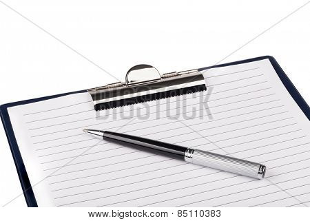 Clip board and pen on a white