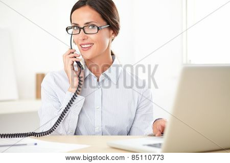 Pretty Businesswoman Using The Phone In The Office