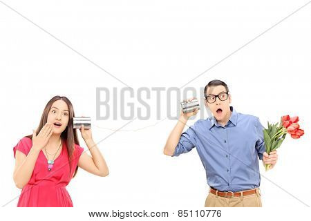 Man and a woman talking through a tin can phone isolated on white background
