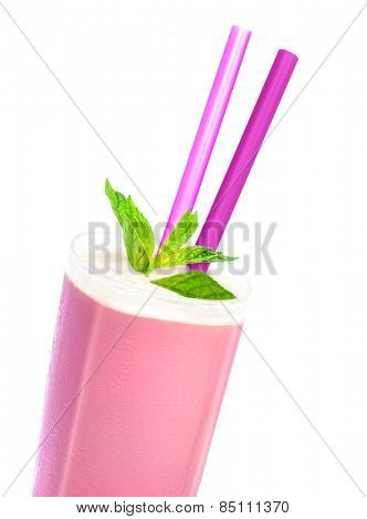 Tasty strawberry milkshake isolated on white background, glass with pink nonalcoholic cocktail decorated with mint leaves and two straw