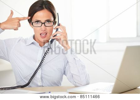 Young Female Secretary Using The Phone
