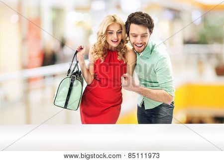 Cheerful couple on shopping trip