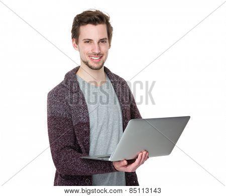 Caucasian man use of laptop
