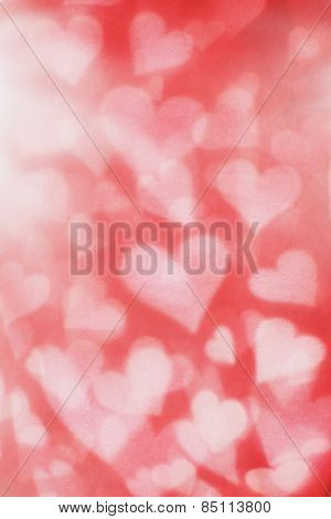 Background texture of blurry and grainy hearts.