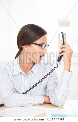 Latin Professional Employee Screaming On The Phone