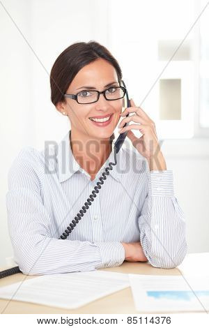 Corporate Secretary Happily Talking On The Phone