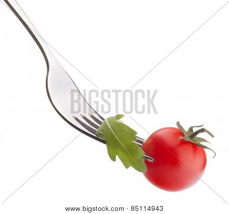 Fresh rucola  salad and cherry tomato on fork isolated on white background cutout. Healthy eating concept.