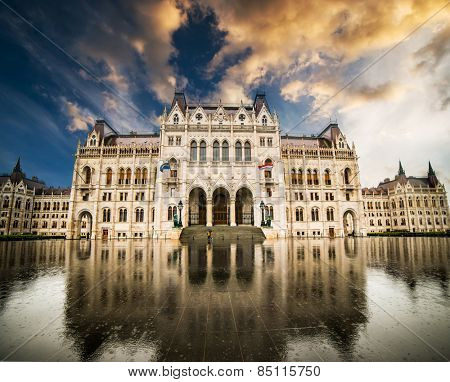 Hungarian Parliament building with reflection  at sunset in Budapest, Hungary