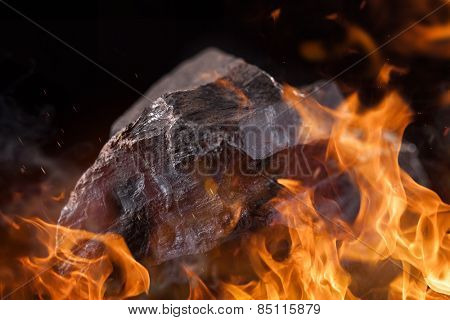 Burning charcoal background with fire flames