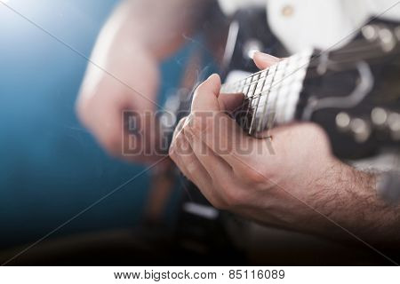 Guitarist on stage in the stage light - retro photo