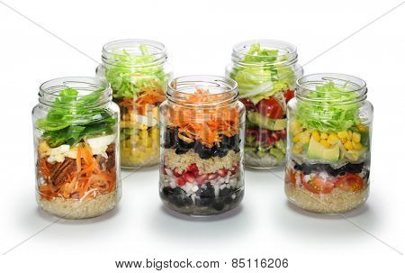 vegetable salad in glass jar on white background, no lid