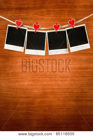 Old photo frames on wood background. Valentines message.