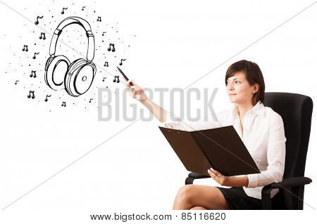 Young girl presenting headphone and musical notes isolated on white
