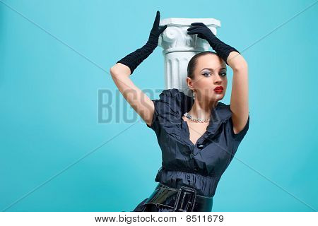 Beautiful fashion girl on the turquoise background