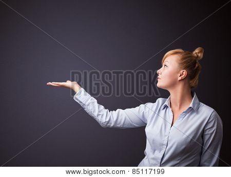 Businesswoman presenting empty space
