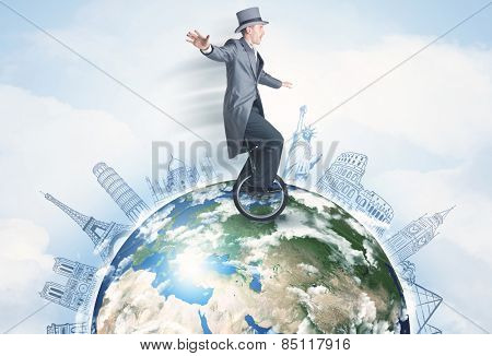 Man riding unicycle around the globe with major cities concept,  ''Elements of this image furnished by NASA