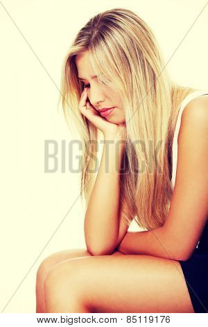 Depressed lonely woman sitting and thinking.