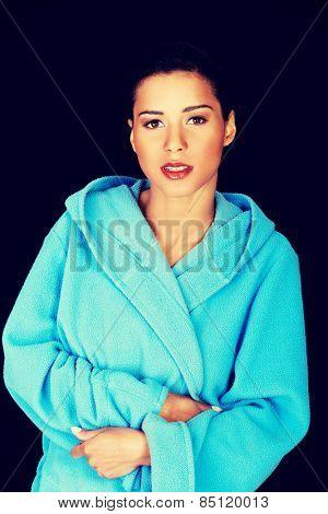 Happy beautiful woman in blue bathrobe.