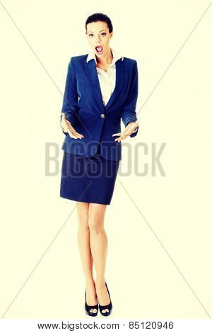 Attractive businesswoman holding something in hands.