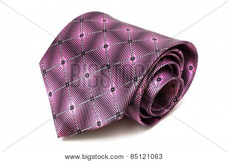folded purple tie on a white background