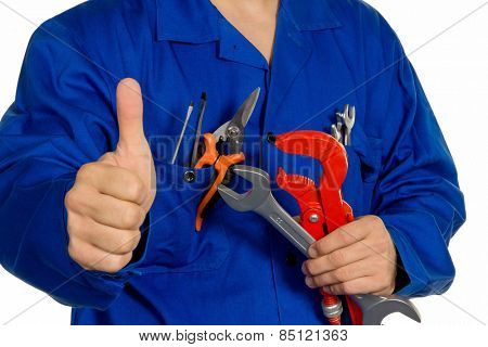 a worker in an industrial enterprise  with tools in hand