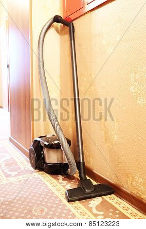 Vacuum cleaner stands in the corridor of the hotel