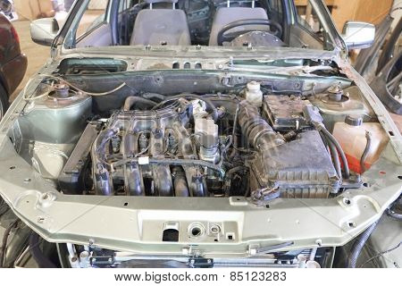 Under the hood of the car. Car is prepared for repair