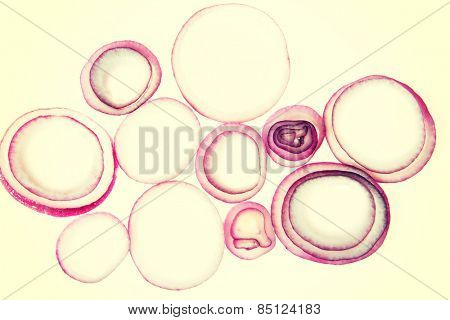 Composition of pilled red onion rings.
