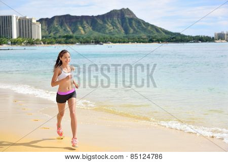 Runner - Sport running fitness woman jogging on beach run Female athlete jogger training living healthy active exercise lifestyle exercising outdoor on Waikiki Beach, Honolulu, Oahu, Hawaii, USA. .