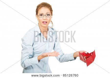 Unhappy businesswoman holding empty purse.