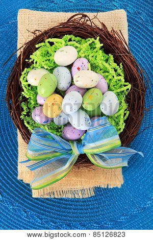 Easter eggs in a nest on a blue background.