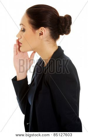 Beautiful businesswoman whispering to someone.