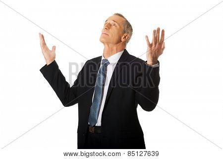Portrait of businessman with hands open gesture.