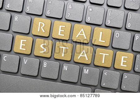 Brown real estate key on keyboard